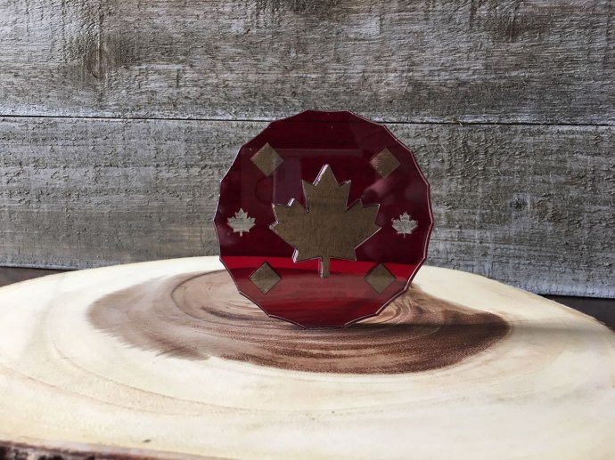 Coaster fashioned from acrylic and reclaimed wood