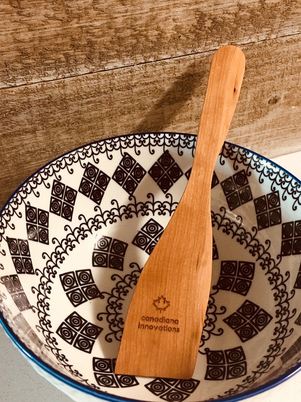 Cherry spatula resting in bowl