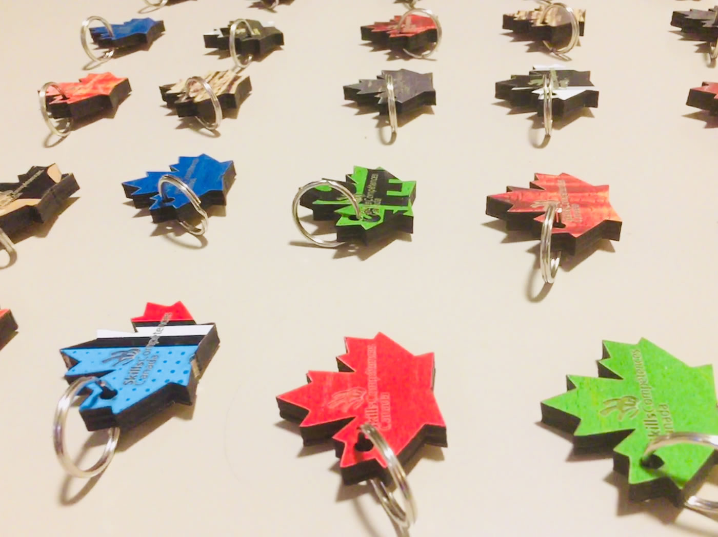 Custom keychains made from recycled skateboards